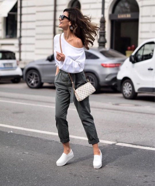 Why not try an alternative to jeans and wear high waisted trousers like these with an off the shoulder blouse, as seen here. Via About A Look. Trousers: Marco Polo.