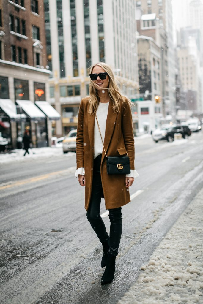 It may be winter in the city, but Amy Jackson knows how to add some warmth, via a rust colored coat. Coat: Zara, Sweater: Ann Taylor, Pants: Zara, Booties: H&M, Handbag: Gucci, Sunglasses: Celine.