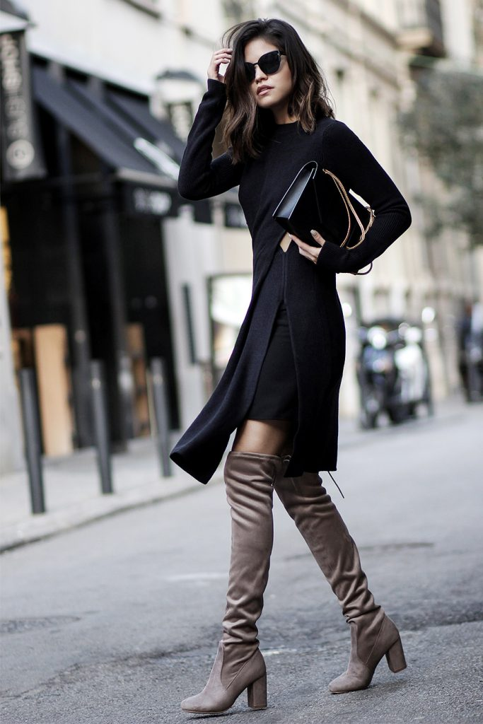 Adriana Gastélum is wearing a mid length slit dress with skin exposing detailing, over the knee grey suede boots, a simple shoulder bag and oversized black cats eye sunglasses.    Dress: Topshop, Sunglasses: Quay, Boots: Chinese Laundry, Bag: Saint Laurent