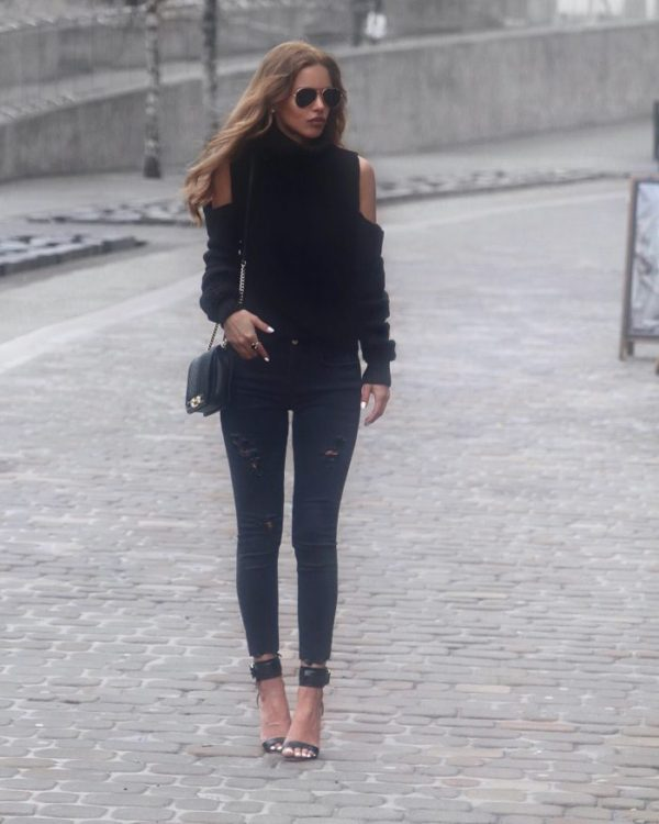 Nada Adelle is wearing black jeans with a matching shoulderless turtle neck sweater, creating an edgy street style which we love. Nada wears this look with open stiletto heels and shades. Jeans: Missy Empire, Jeans: River Island.