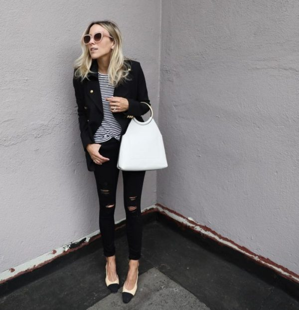 Jacey Duprie has paired black jeans with a horizontally striped tee, a striking white handbag, and a chic leather jacket. Wear this look with heels to capture Jacey's style. Tee: J Crew, Jeans: Rag and Bone, Shoes: Chanel, Jacket: Intermix.