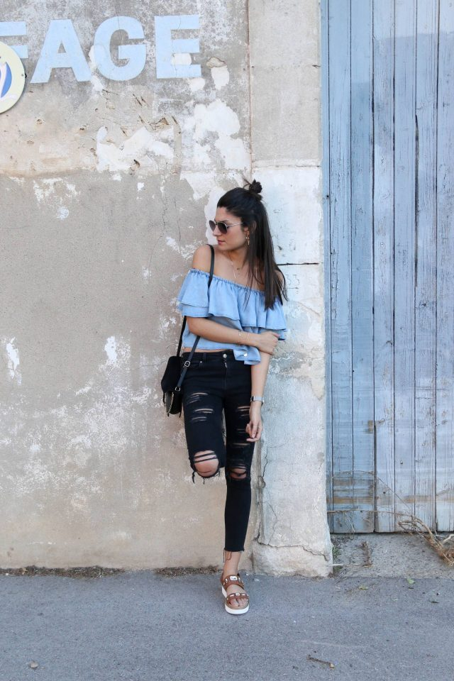 48926d88f39 Distressed black jeans are the perfect match to an off the shoulder layered  top like this one! Federica L. has created a simplistic summer style here