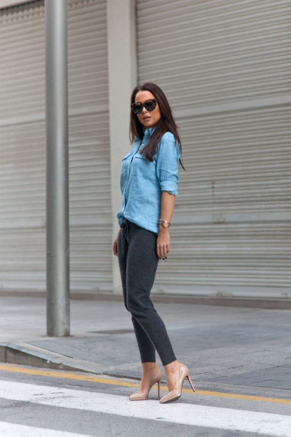 Johanna Olsson rocks this stylish combo of a light blue linen shirt, tapered grey joggers and trendy nude heels. This look is ideal for every day wear, and is capable of being dressed up or down for formal or lounge wear. Shoes: Christian Louboutin, Sunglasses: Illestreva, Shirt: By malina, Trousers: James Perse.