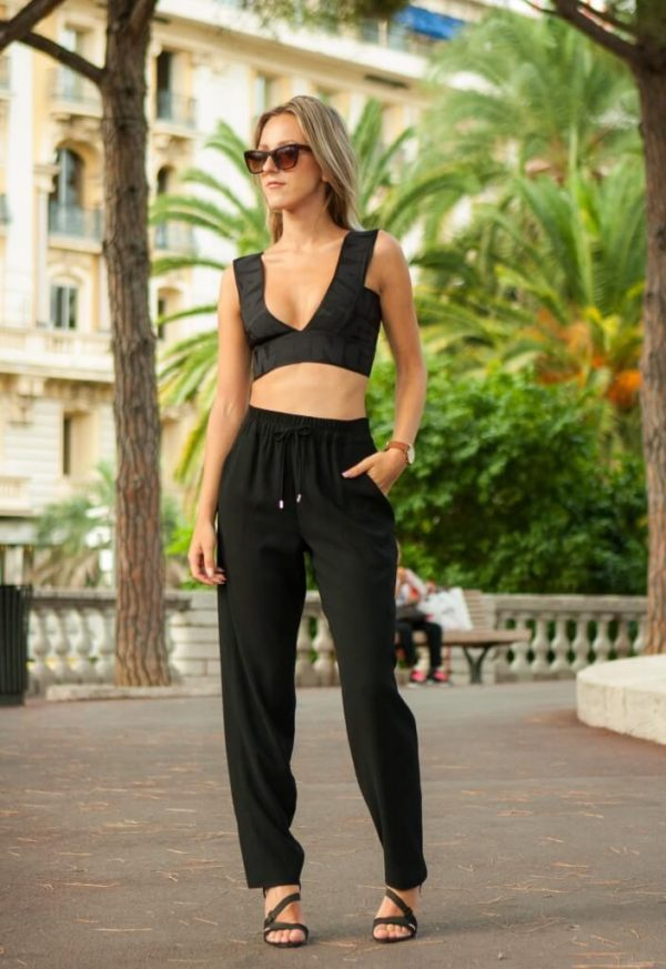 Consider wearing joggers with a crop top in warmer weather for the perfect beach look! Via Anna Belle Clarenburg. Top: Alexander Wang for H&M, Joggers: Karen Miller, Heels: Zara, Watch: Rosefield. Outfits With Joggers.