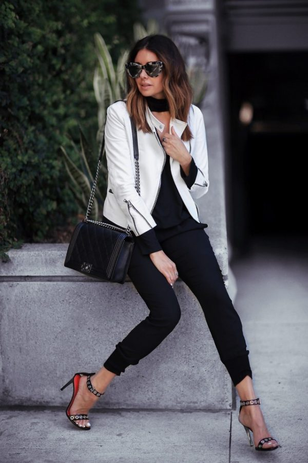 Erica Hoida has created a totally elegant jogger style here, choosing to accessorise this pair of cropped black joggers with wide rimmed shades and a pair of extravagant polka-dotted stilettos. Wearing a white leather jacket will also always result in a stylish and sophisticated look. Jacket: The Perfext, Top: Rachel Pally, Pants: Vince, Shoes: Proenza Schouler, Bag: Chanel.