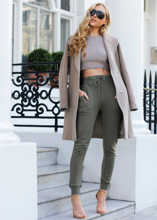 Hollie Hobin is revolutionising casual joggers, creating a stylish look by wearing a khaki pair with a cute neutral crop top and a matching plush coat. Try this look with heels to steal Hollie's elegant style! Top: Forever 21, Joggers: Missguided, Heels: Stuart Weitzman, Coat: Whistles.