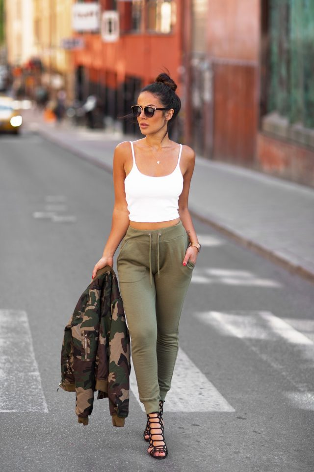 Sharareh Sophia Hosseini has taken a simple but effective choice to wear joggers with a crop top for an easy summer style. We love the coordinated colours of this outfit, and the camouflage jacket just adds another element to the look. Joggers/Jacket: Missguided, Top: Bikbok, Shoes: Steve Madden.