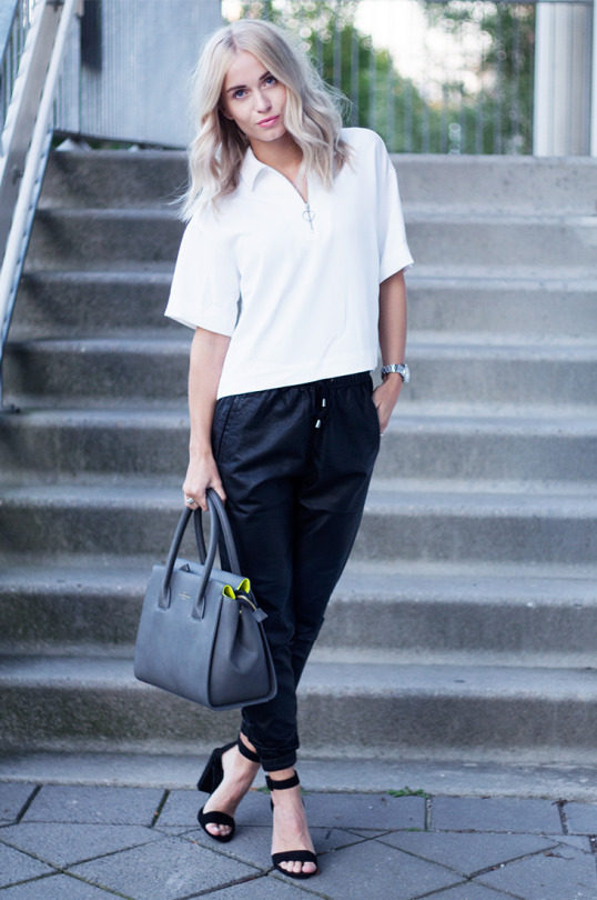 The leather jogger trend looks best worn simply with a minimalistic blouse like this one worn by Anita. Trousers: The Sting, Heels: Zara, Bag: Paul's Boutique.