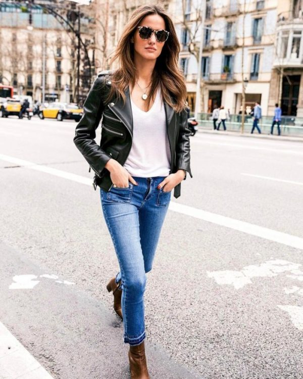 Alex Riviere is wearing this leather jacket with a simple white V neck tee, denim jeans, and a pair of leather ankle boots. This look works best with simple jewellery and accessories. Jacket: Anine Bing