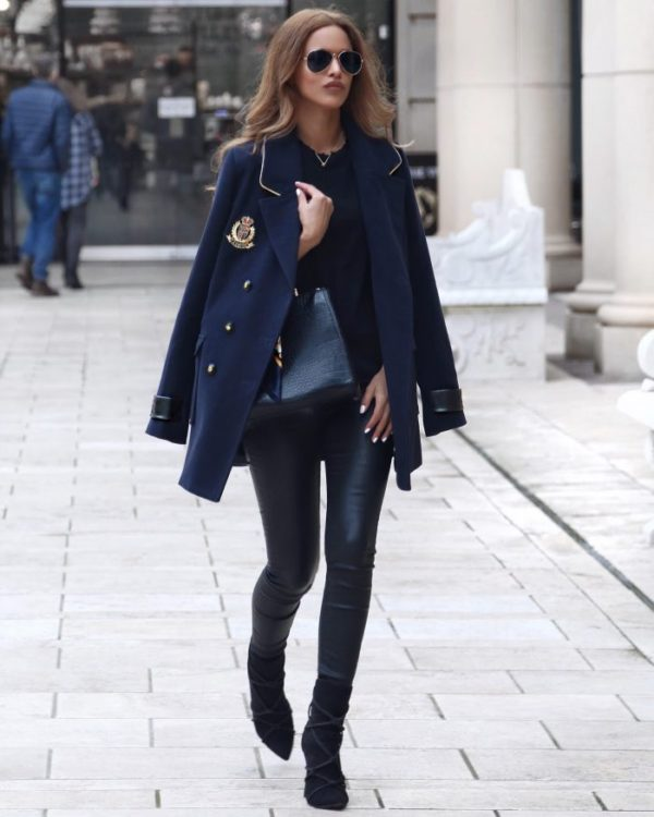 Nada Adelle wears a gorgeous royal blue military coat, with double breasted buttons and a marine style emblem on the chest. She pairs this piece with leather leggings and suede black boots. Coat/Leggings: Missguided.