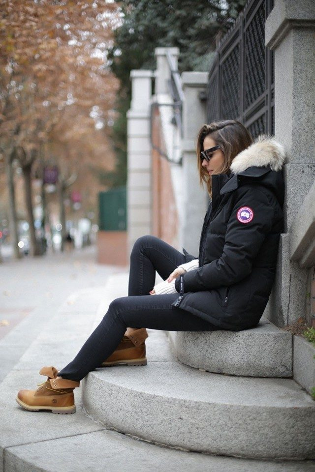 Timberlands are the perfect item to break up an all black winter outfit. Silvia Zamora wears this pair with black denim and a cool Canada Goose parka with a faux fur hood. One way how to wear timberland boots. Parka: Canada Goose, Jeans/Jumper: Zara, Sunnies: Céline.