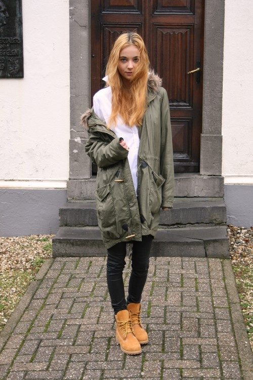 Anne,Miek Kessels wears a classic khaki parka and skinny black jeans with  her Timberlands; a casual and easy style with a bit of edge to bring in the  winter
