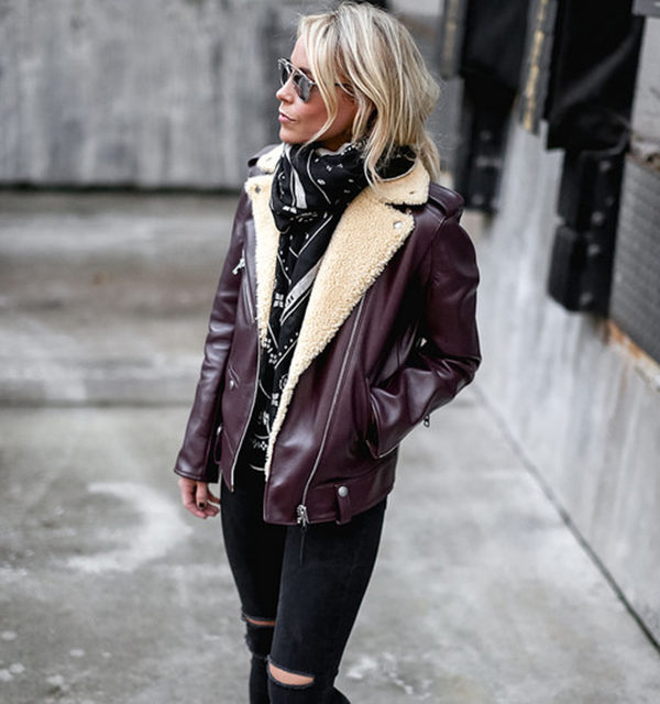 Mary Seng wears a burgundy shearling trim jacket with a statement patterned monochrome scarf and ripped denim jeans. Jackrt/Scarf: Coach, Tank: Shopbop, Jeans: J Brand.