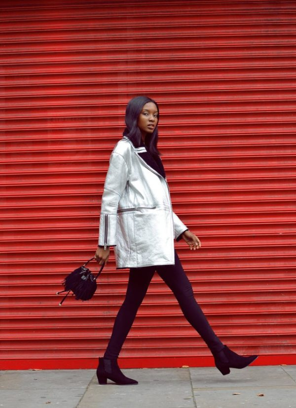 The shearling trend should not be restricted to just leather or suede. Natasha Ndlovu shows us how to rock shearling and metallic fabric on this funky winter jacket. Coat: J.Lindeberg, Leggings: H&M, Shoes: Office, Bag: Zara.