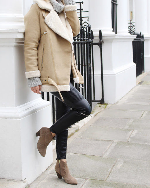 Beige shearling is a definite trend. We love Chrissabella Pink's choice to pair her jacket with cropped leather leggings and ankle boots. Opt for a knitted sweater too if you desire extra cosiness. Jumper: COS, Boots: My Habit.