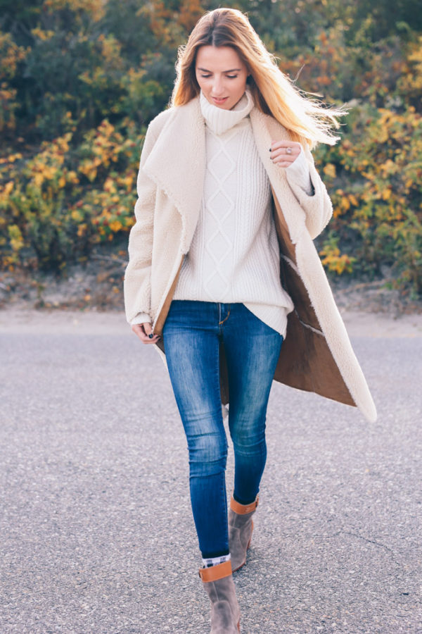 Jess Ann Kirby wears a fully shearling coat, we love this look. Jacket: Velvet, Sweater: Talbots.