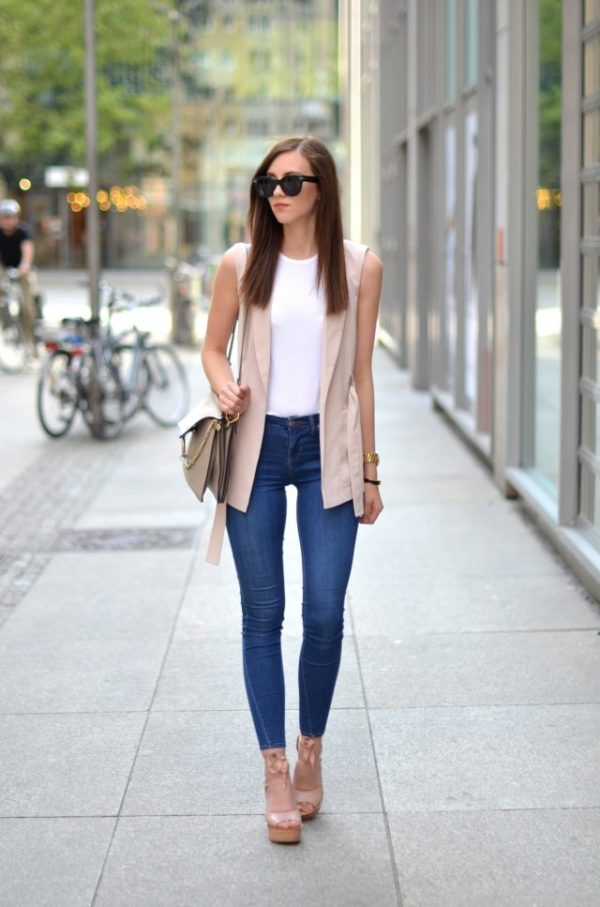 These 15 Blogger Outfits Will Show You How To Wear A Sleeveless Jacket - Just The Design
