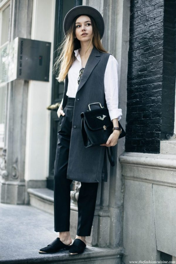 Beatrice Gutu is rocking this androgynous style consisting of a long sleeveless jacket, a crisp white shirt, and a pair of high waisted trousers. This look is ultra sophisticated, and will do for either work wear or for a smart casual everyday style! Shirt: Calvin Klein, Jacket: Zelle, Trousers: Zara, Shoes: Asos, Hat: Brixton.