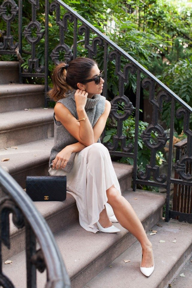 This grey sleeveless turtleneck is the perfect match to Krystal Bick's sheer white maxi dress. Wearing the trend with a dress or skirt of any length is sure to look great. Sweater/Dress: Rachel Roy, Shoes: Manolo Blahnik, Bag: Chanel.