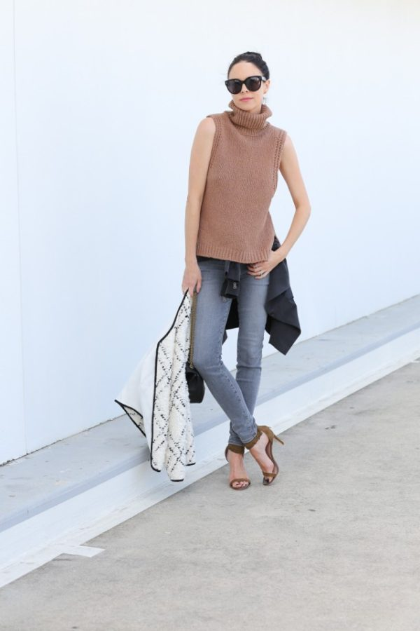 This beige sleeveless turtleneck looks ultra sophisticated worn with faded jeans and heels. We recommend wearing the trend in a similar simple style. Via Fiona Edwards. Tank: Enza Costa, Coat: Ulla Johnson, Jeans: J Brand, Shoes: Joie Clothing, Additional Jacket: Helmut Lang, Sunglasses: Celine, Bag: Jerome Dreyfuss.