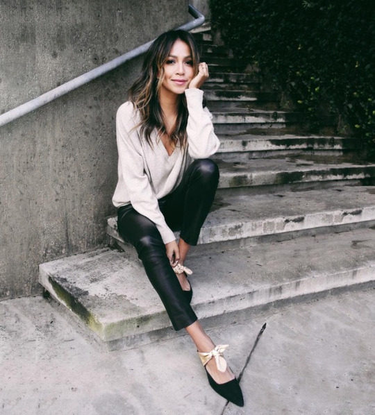 cd46634151 Julie Sarinana is wearing a pair of leather leggings with a V neck blouse  and ballet