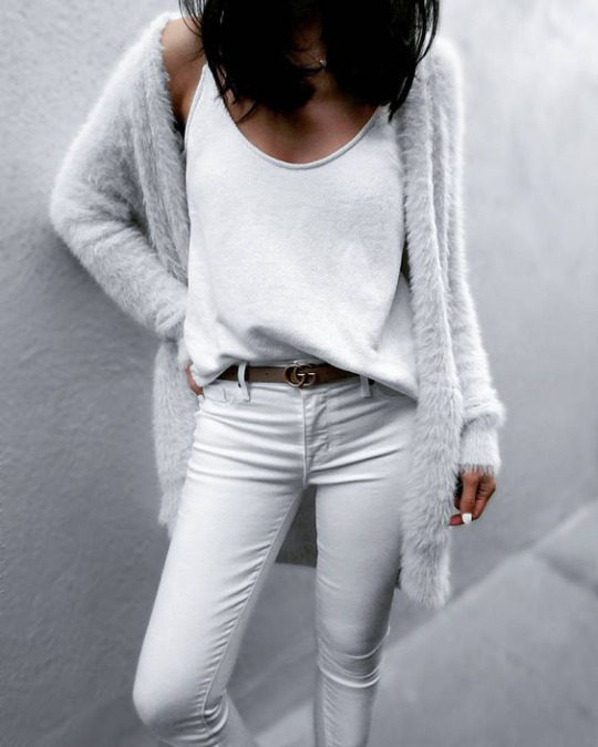 Jazy Goh is killing it in an all white spring outfit, consisting of jeans, a tank top, and a gorgeously soft faux fur cardi from Asos. Wear this look with a leather belt to break up the total white wash of this style. Top: Saboskirt, Cardi: Asos, Jeans: Parker Smith.