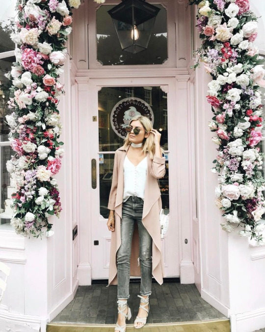 Emily Luciano has the perfect spring palette here, in shades of pastel pink, marl grey, white and cream. Emily wears grey jeans with an oversized blush cardigan and white strappy heels. Brands not specified.
