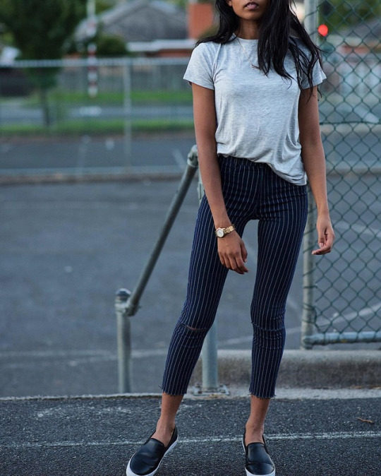 For a fashionable alternative to jeans, wear pinstriped trousers like these, paired here with a simple grey tee and patent leather Adidas flats. Via Pose & Repeat. Tee: Zara, Shoes: Adidas Originals.