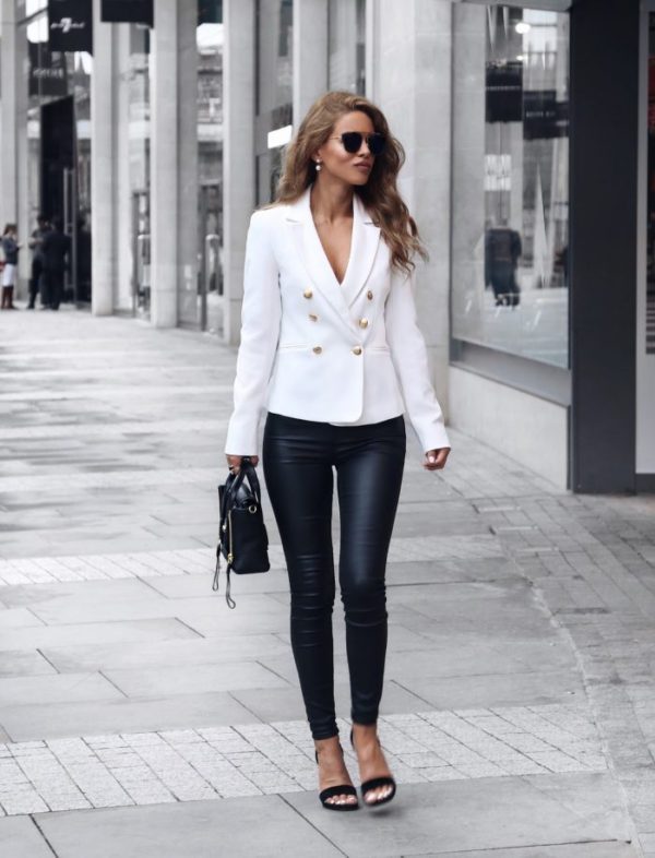 Nada Adelle is ultra glamorous in this spring style, consisting of leather leggings paired with a gorgeous white double-breasted blazer. With gold buttons and a plunging neckline, this blazer is perfect for dressing up. Blazer: Miss Selfridge, Trousers: Asos, Shoes: Saint Laurent.