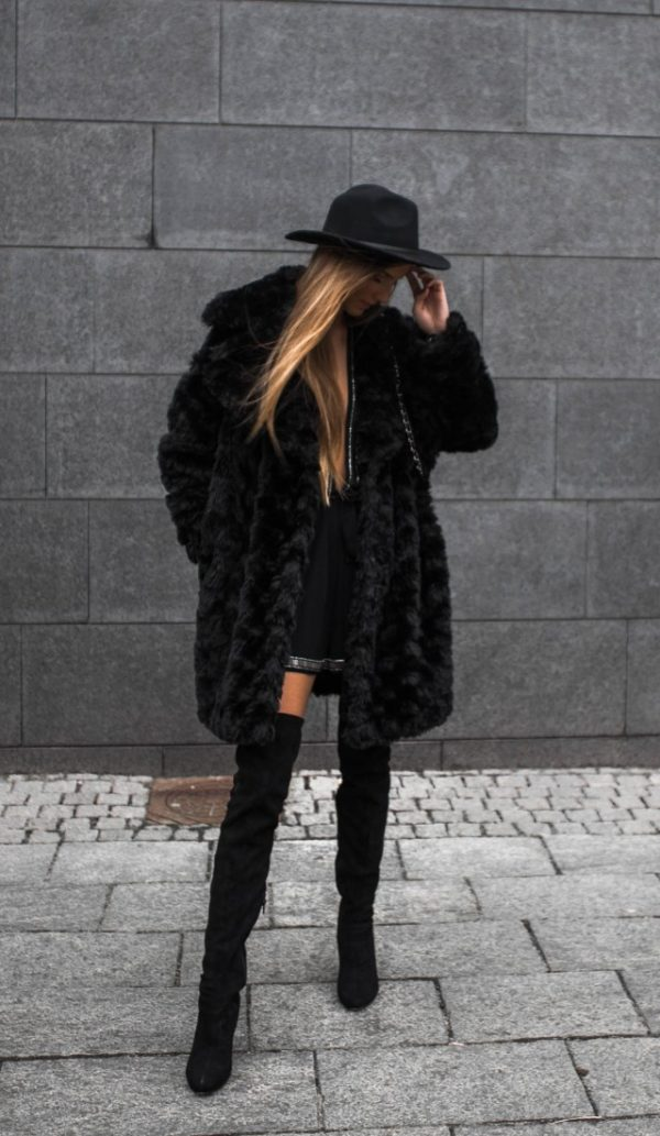 b6c0280645ed ... ultra glam in this faux fur and thigh high boots outfit. Wear the look  with a cute fedora or bowler hat to recreate this classy and feminine style.
