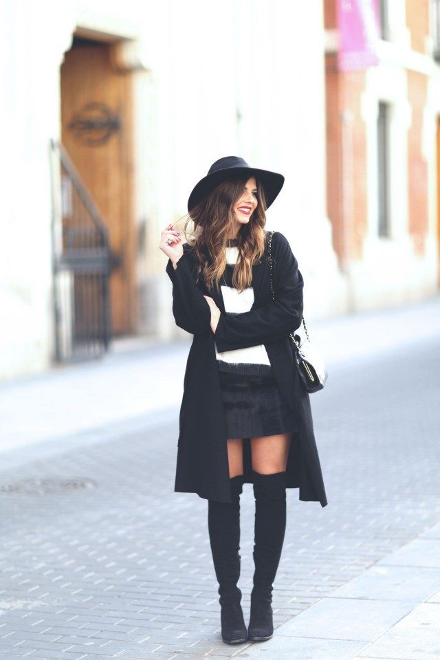 e3f1d29c9a1a Wondering how to wear thigh high boots with a skirt  Natalia Cabezas pairs  these boots with an adorable mini skirt from Zara combined with a stylish  sweater ...