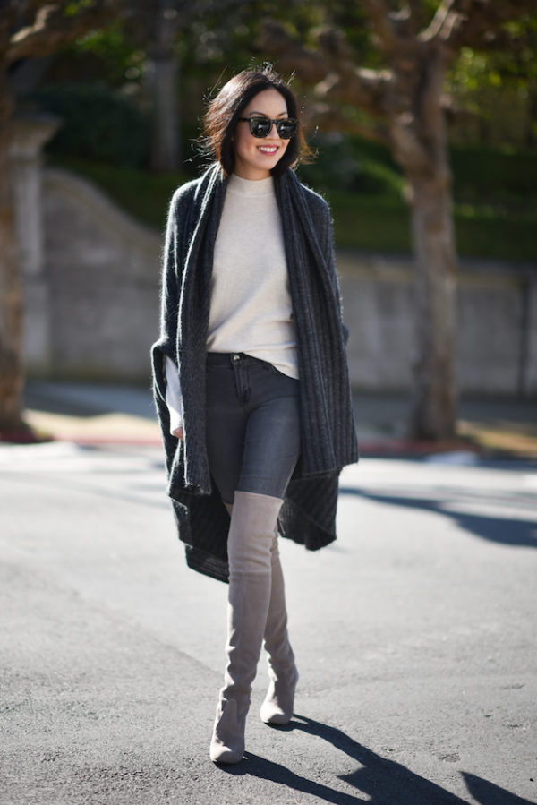 504cc16f5c3 Ann Taylor is wearing over the knee boots with classic skinny jeans and a  long cable knit cardigan