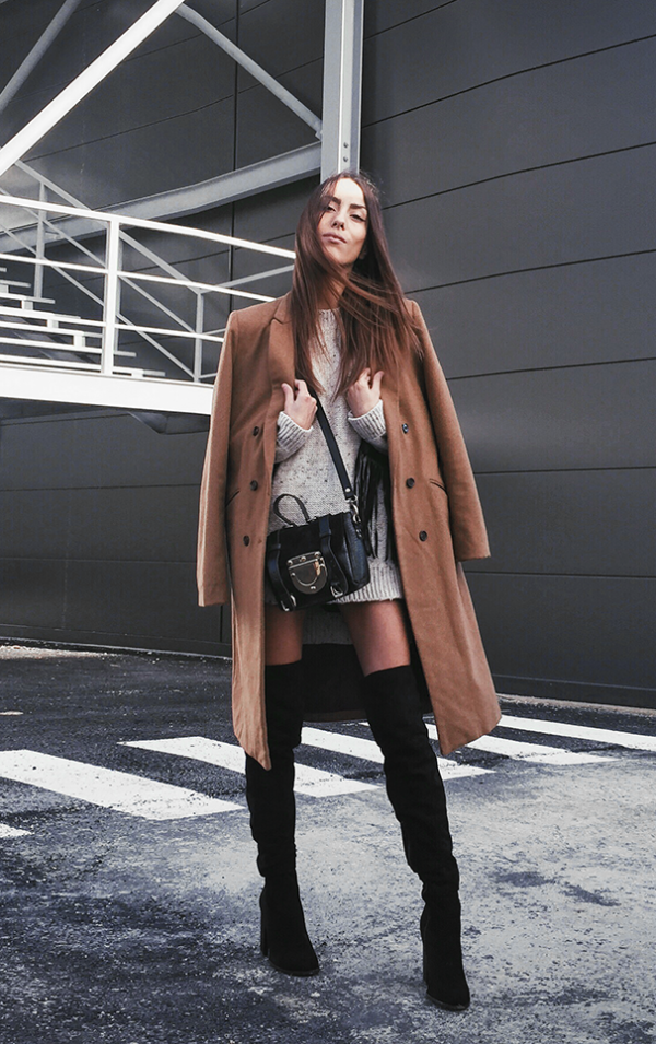 2cc92c238dd Sofia Reis goes for a sophisticated and elegant aesthetic  pairing thigh  high black boots with a cute knit sweater and a broadly styled camel coat.