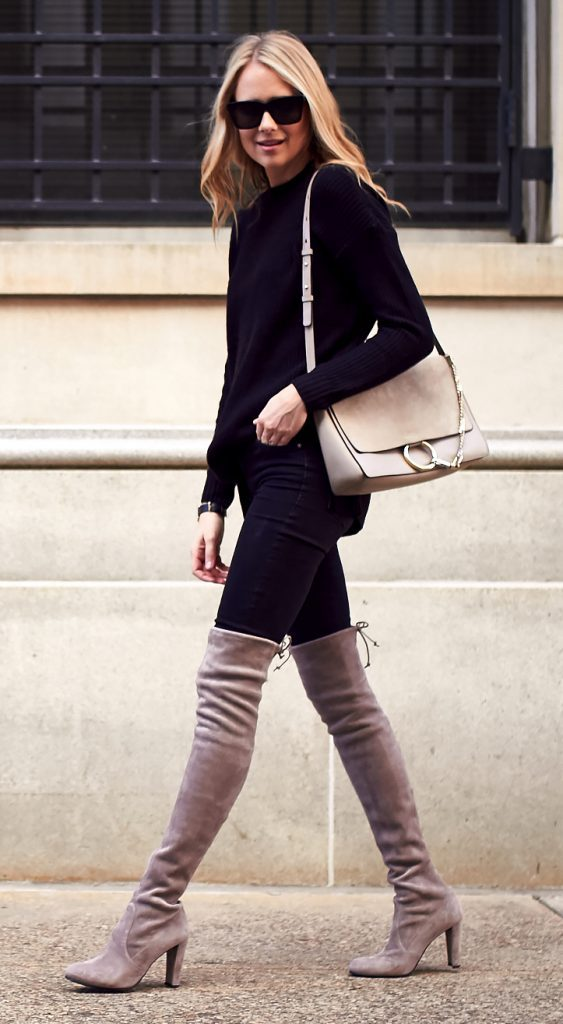 26e7242018bd ... a glamorous fall style here, totally owning the vibrant contrast of the  beige boots and otherwise black outfit. Wear a coloured pair of thigh high  boots ...
