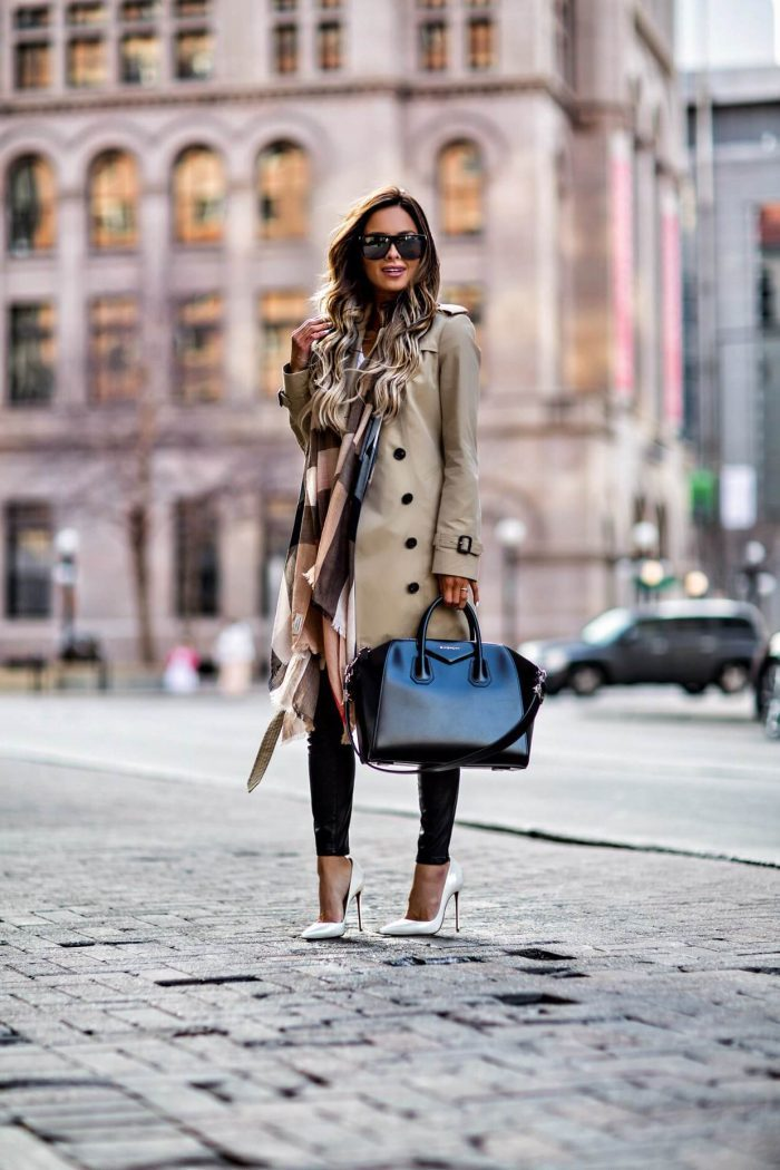 Maria Vizuete wears a classic beige trench coat with white stilettos and an oversized scarf to create this street-chic look! Trench: Burberry, Shoes: Christian Louboutin.